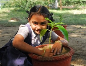 A young girl learning how to care for her environment.